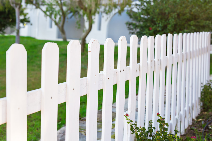 A Picture of A Wooden Fence With Old Slats That Need To Be Repaired And Replaced By Delco Fencing