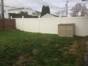 A Picture Of A White Vinyl Fence Installed On A Small Plot Of Land Delco Fencing