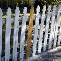 A Small Repair Of A Slat On A Wooden Fence By Delco Fencing