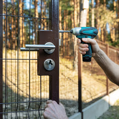 Delco Fencing Installing A Custom Latch And Lock On A Custom Concrete Footed Fence