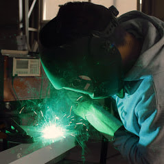 A Picture Of Our Shop Guys Welding Up Some Custom Fence Accessories For The Special Customers We Acquire Delco Fencing