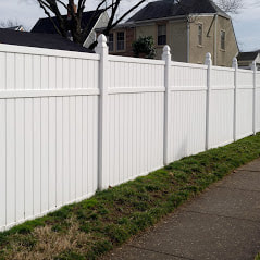 A Picture Of A Nice White Vinyl Fence Installed By Delco Fencing With A Different Type Of Post That Was A Custom Request By The Customer
