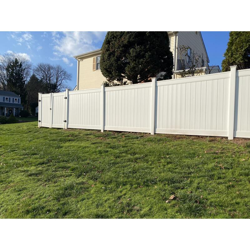 A Picture Of A The White Vinyl Fence That Delco Fencing Had To Come In And Fix After The Customer Tried To Install It. You Can See The Difference