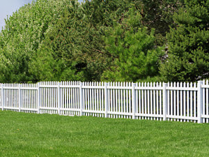 A Picture Of White Vinyl Fence That Looks Like Wrought Iron A Custom Install By Delco Fencing