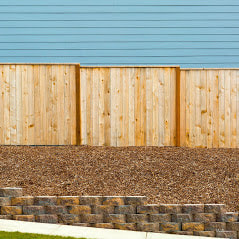 A Picture Of A Wood Fence Built On Top Of A Retaining Wall 5 Feet From A Sidewalk In Delaware County Pa